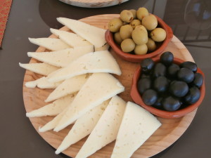 Juicy olives and manchego cheese.