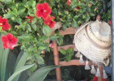 Rattan chair and sun hat